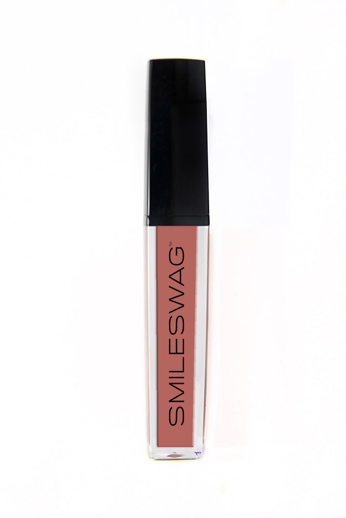 Blue-based pink liquid lip gloss by SmileSwag