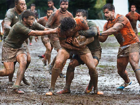 rugby team in mud