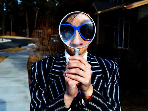 someone holding a magnifying glass