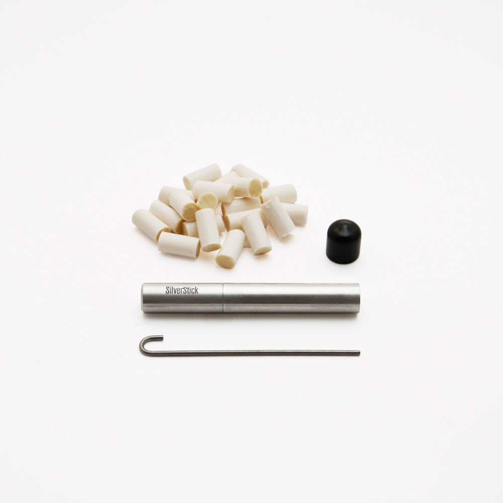 SilverStick metal one-hitter taster pipe with cotton filters, end cap, and poker