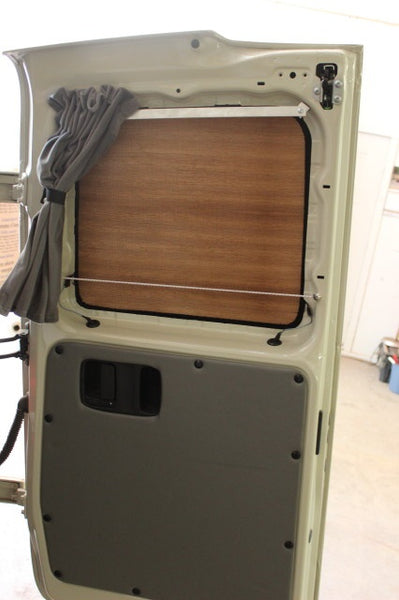 Metris dark wood insulation panel on rear door