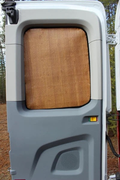 NV rear window covers in wood grain - shown on a Transit
