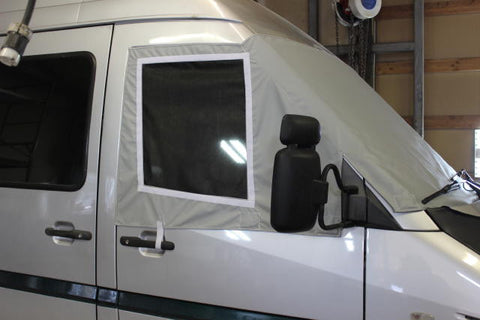 Promaster cab cover with screens shown on Sprinter
