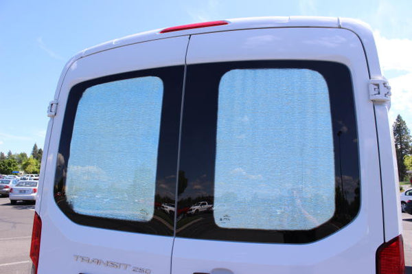 Promaster mix and match rear door window insulation panels outside view on a Transit van