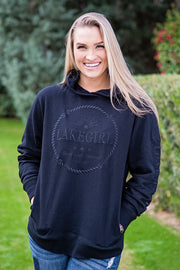 Lakegirl crossover neckline hoodie in black french terry with tonal embroidered designs on the front and left sleeve. A great summer-weight hoodie perfect for evenings at the lake.