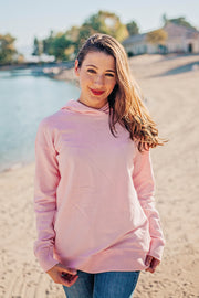 Lakegirl crossover french terry hoodie in soft almond blossom pink. A great summer-weight hoodie perfect for evenings at the lake.