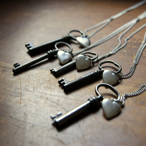 Necklace made with a vintage skeleton key and a vintage silver plated brass heart locket by Wear Your Wild.