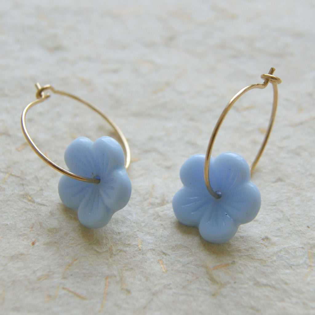 Gold filled hoop earrings with light blue vintage glass flower beads.