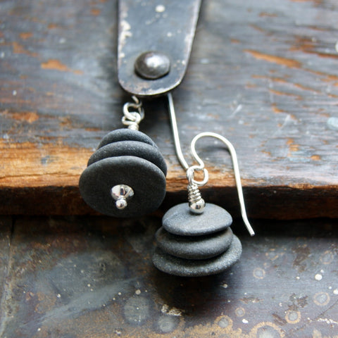 Cairn earrings made with three gray river stones and sterling silver.