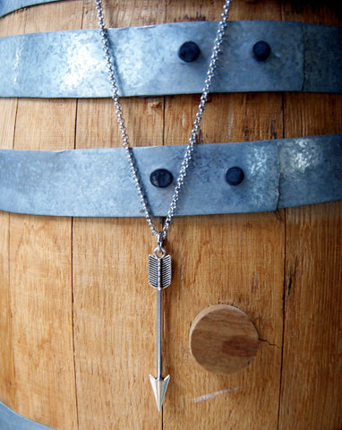 Silver arrow necklace hanging from a stainless steel rolo chain by Wear Your Wild