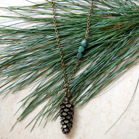 Large Antiqued Bronze Pine Cone Necklace with a Trio of Emeralds