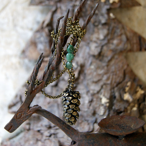 Large Antiqued Bronze Pine Cone Necklace with a Trio of Emeralds by Wear Your Wild
