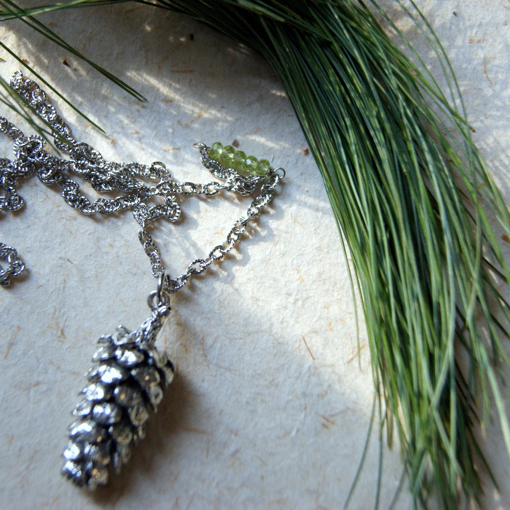 Large Antiqued Silver Pine Cone Necklace with Peridot Beads by Wear Your Wild