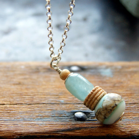 Aquamarine Cairn Necklace with Tea Dyed Bone, Lampwork Glass and Crinoid Fossil