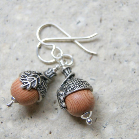 Acorn earrings made with rosewood beads and antiqued silver acorn bead caps.