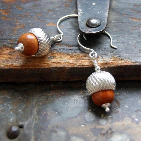 Acorn earrings made with redwood beads and silver acorn caps by Wear Your Wild.
