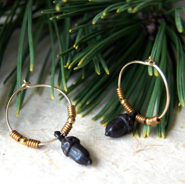 Gold filled hoop earrings with blackened pewter acorns and vintage brass beads.