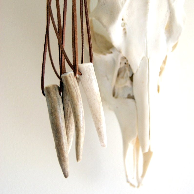 Real deer antler tip necklace with rust colored faux leather cord.