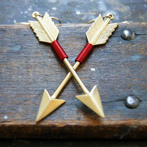 Brass arrow earrings wrapped with colored wire. The color can be chosen at checkout. by Wear Your Wild