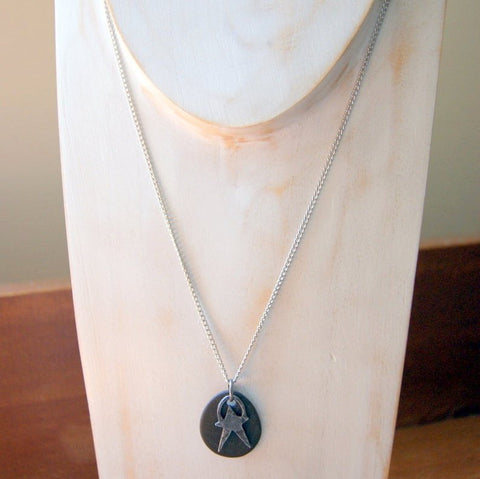 Black Beach Stone Necklace with Pewter Star Charm