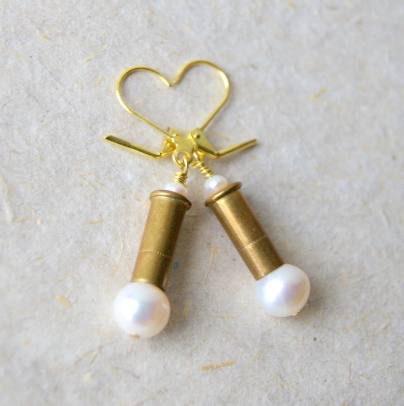 Bullet earrings made with spent 22 brass rifle shells, white freshwater pearls and brass leverback earwires.