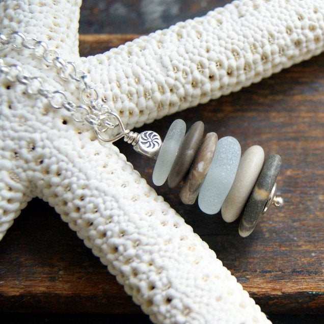 Cairn necklace made with beach stones and white sea glass by Wear Your Wild