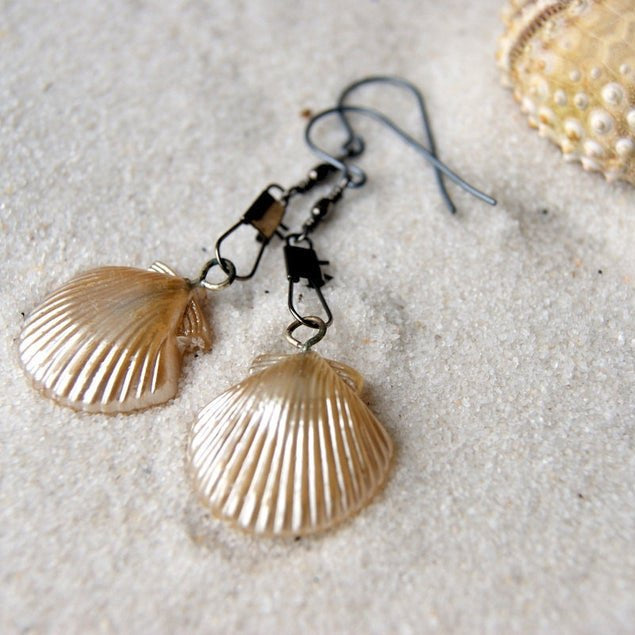 Earrings made by combining vintage chippy glass pearl shells and gunmetal colored swivel snaps.