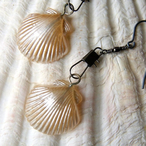 Earrings made by combining vintage chippy glass pearl shells and gunmetal colored swivel snaps by Wear Your Wild