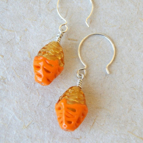 Earrings made with vintage orange and gold glass lace beads hanging from sterling silver earwires by Wear Your Wild