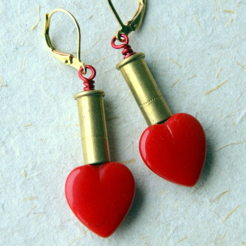 Bullet earrings made by combining vintage red glass heart beads with brass 22 rifle shell casings.