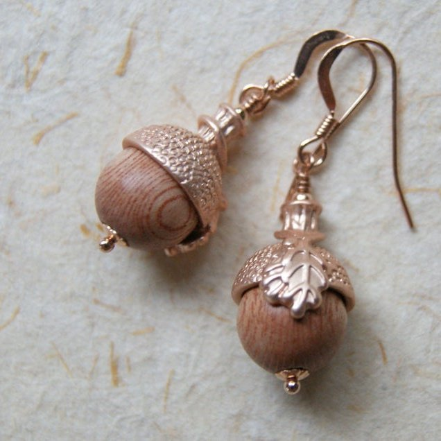 Acorn earrings made with rosewood beads and rose gold plated acorn bead caps by Wear Your Wild.