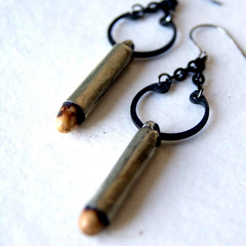 Earrings made with antique fertility beads and retaining rings by Wear Your Wild.