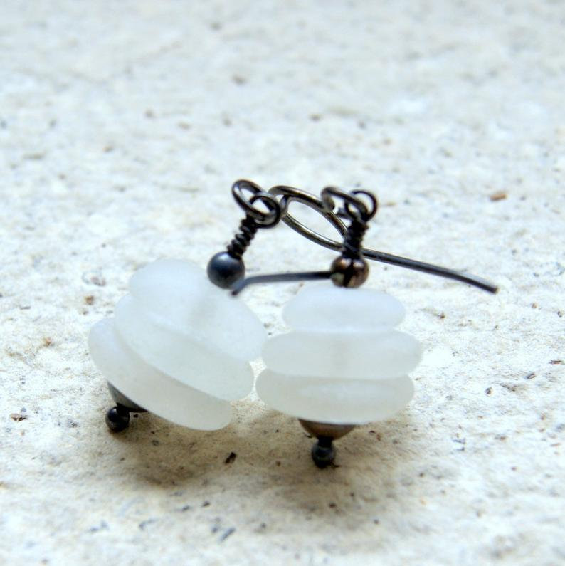 Cairn earrings made with three white genuine sea glass pieces and oxidized sterling silver.