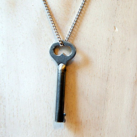 An antique skeleton heart key necklace made by combining a vintage key with a vintage stainless steel chain by Wear Your Wild.
