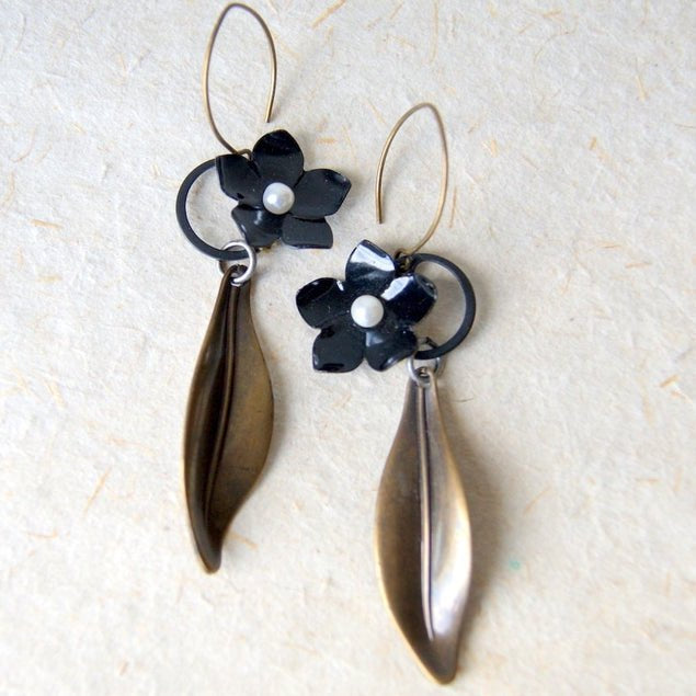 Earrings made by combining vintage black enamel flowers with black steel retaining rings by Wear Your Wild