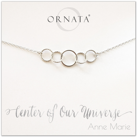 Center of our Universe necklace - personalized silver necklaces. Our sterling silver custom jewelry is a perfect gift for best friends, sisters, daughters, or mothers. Inspirational jewelry is also a good gift for Mother's Day. Interlocking silver rings represent family and friendship.