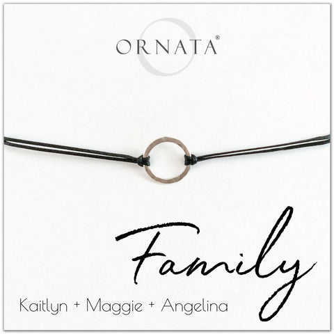 Family personalized sterling silver corded bolo bracelet. Our custom cord bracelets make good gifts for moms, mothers, family members, grandmothers, daughters, sisters, or even fathers. Family bracelet with one sterling silver ring on black cord to represent the bond of your family. Customize with the names of your family members. Great custom Mother's Day gift.