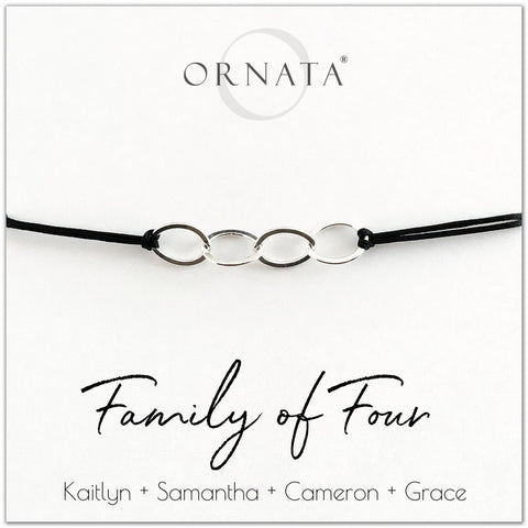 Family of Four personalized sterling silver corded bolo bracelet. Our custom cord bracelets make good gifts for moms, mothers, family members, grandmothers, daughters, sisters, or even fathers. Family bracelet with four sterling silver rings on black cord to represent the 4 members of your family. Customize with the names of your family members. Great custom Mother's Day gift.