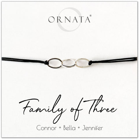 Family of Three personalized sterling silver corded bolo bracelet. Our custom cord bracelets make good gifts for moms, mothers, family members, grandmothers, daughters, sisters, or even fathers. Family bracelet with three sterling silver rings on black cord to represent the 3 members of your family. Customize with the names of your family members. Great custom Mother's Day gift.