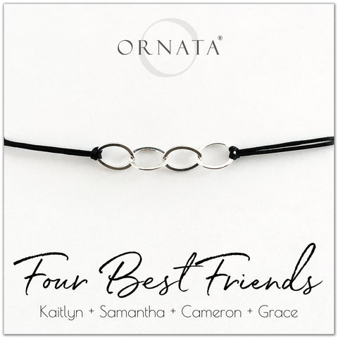 Four best friends personalized sterling silver corded bolo bracelet. Our custom cord bracelets make good gifts for best friends or sisters. Friendship bracelet with four sterling silver interlocking rings on black cord.