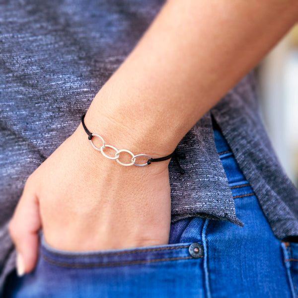 Personalized bracelet - sterling silver friendship bracelet for four best friends - custom jewelry for friend or sister. This 4 best friends bolo cord bracelet features four interlocking rings to represent 4 best friends.