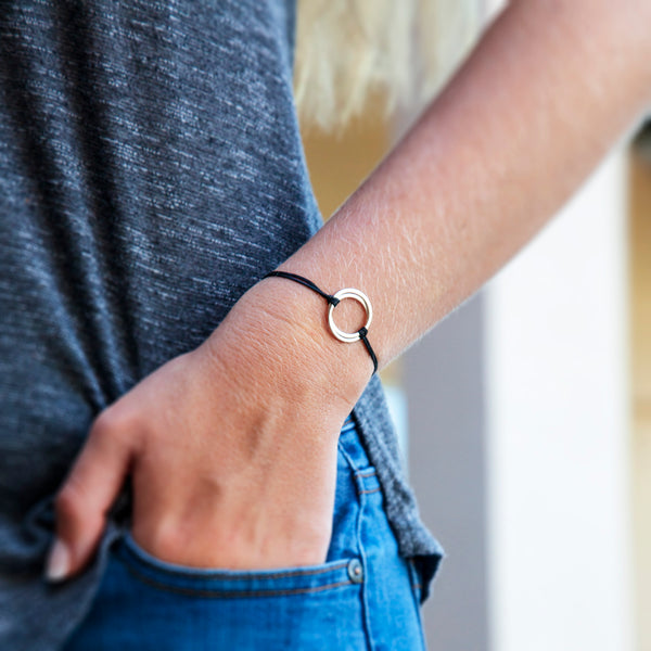 Personalized friendship bracelet - sterling silver friendship bracelet for best friends or soul sisters - custom jewelry for friend or sister. This bolo cord bracelet features two interlocking rings to represent best friends or soul mates or sisters.