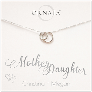 Mother Daughter necklace - personalized silver necklaces. Our sterling silver custom jewelry is a perfect gift for mothers and daughters, wives, or family members. Also a good gift for Mother's Day or a gift for daughters to give their mothers. Delicate sterling silver interlocking rings represent a mother and daughter.