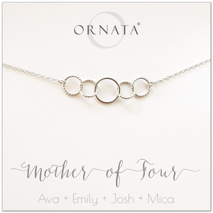 Mom or Mother of Four - personalized silver necklaces. Our sterling silver custom jewelry is a perfect gift for mothers of four children, wives, or family members. Also a good gift for Mother's Day. Delicate sterling silver interlocking rings represent a mother and her four children.