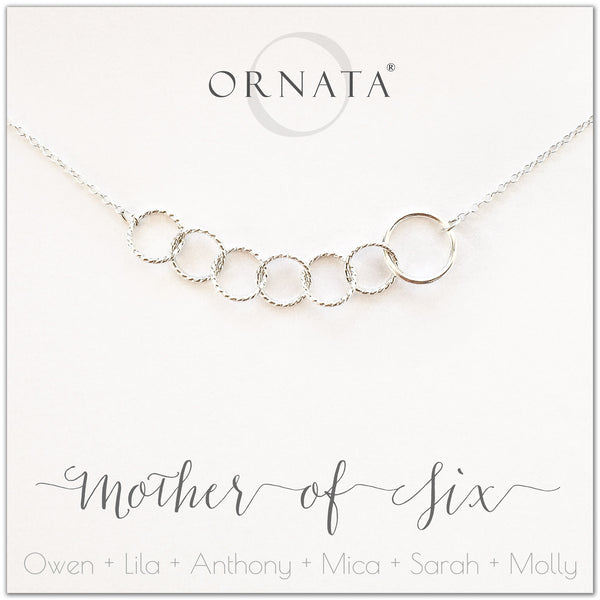 Mom or Mother of Six - personalized silver necklaces. Our sterling silver custom jewelry is a perfect gift for mothers of six children, wives, or family members. Also a good gift for Mother's Day. Delicate sterling silver interlocking rings represent a mother and her six children.