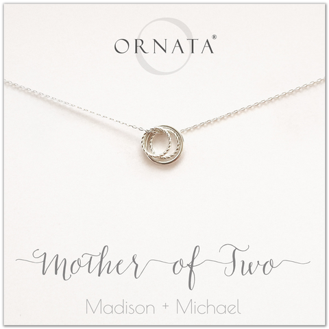 Mom or Mother of Two - personalized silver necklaces. Our sterling silver custom jewelry is a perfect gift for mothers of two children, daughters, granddaughters, grandmothers, sisters, best friends, wives, girlfriends, and family members. Also a good gift for Mother's Day. Delicate sterling silver rings represent a mother and her two children.