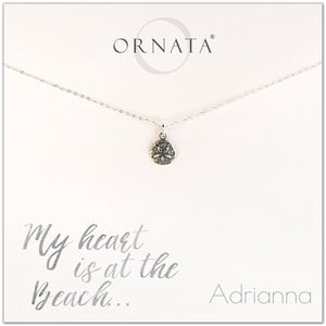 My heart is at the beach. Personalized silver sand dollar necklace. Our sterling silver custom jewelry is a perfect gift for people who love the ocean, the sea, seashells, or the beach.