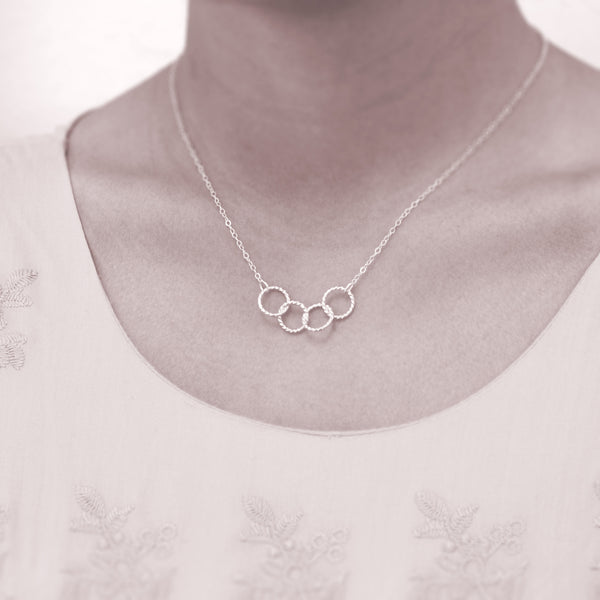 Custom 4 best friends necklace - personalized jewelry is sterling silver and the custom friendship necklaces are good gifts for best friends or sisters. Represents four best friends with 4 sterling silver interlocking rings.