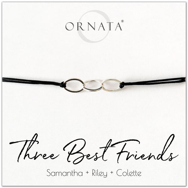 Three best friends personalized sterling silver corded bolo bracelet. Our custom cord bracelets make good gifts for best friends or sisters. Friendship bracelet with three sterling silver interlocking rings on black cord.