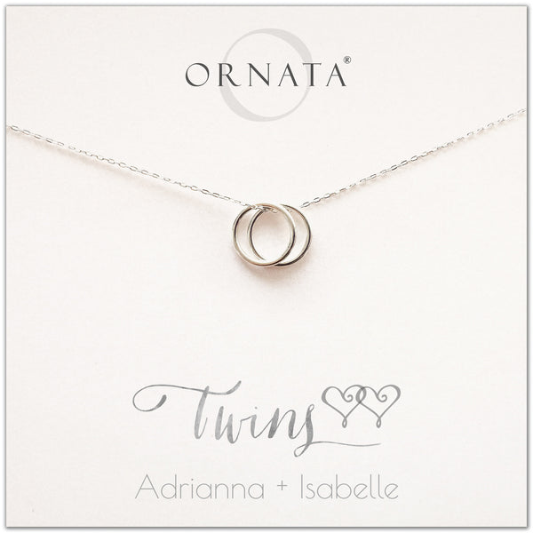 Personalized twins necklace. Our sterling silver custom jewelry is a perfect gift for best friends, sisters, BFFs, moms, and mothers of twins - symbolic necklace to represent twin sisters with two silver interlocking rings. Good gift for best friend or sister or mom of twins.